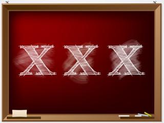 XXX text drawn on red chalkboard