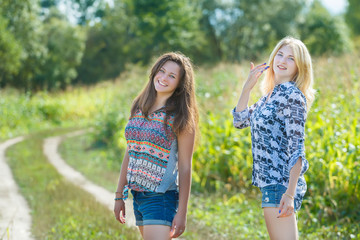 Friends standing at farm field background