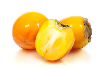 Persimmons. Ripe persimmon with slice. Clipping path included