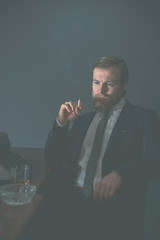 Vintage businessman sitting smoking