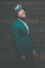 Man with Goatee in Elegant Green Formal Outfit