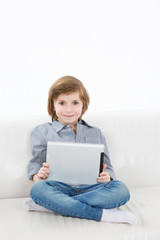 Smiling boy and touchpad