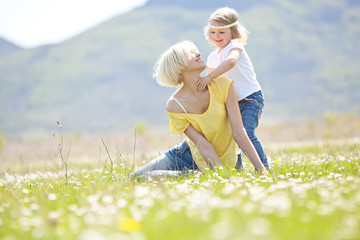 Happy woman with a child resting on the nature