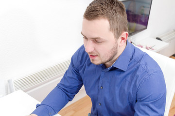 Young business man work in modern office on computer