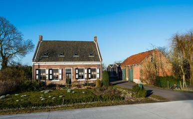 Historic Dutch farmhouse with a barn