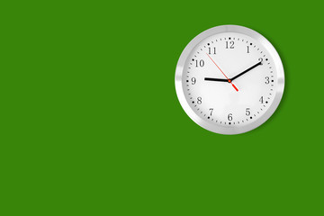 classic clock on green background with copy-space