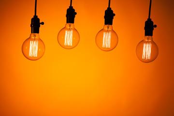 multitude of bulb lamps on orange background