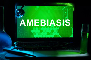 Computer with words amebiasis. Medical concept.