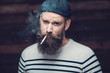 Close up Attractive Male Smoker with Long Beard - 79546055