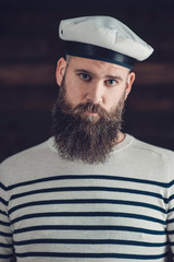 Man with Goatee in Stripe Shirt and Sailor Hat