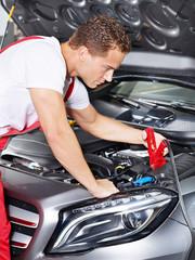 Car mechanic in a garage
