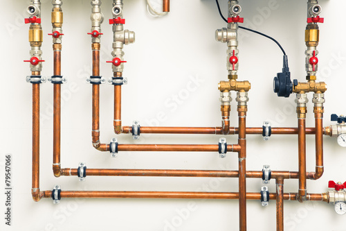 copper pipes in boiler-room - 79547066