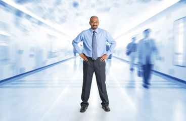 Indian businessman standing at corridor