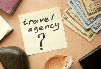 Travel agency paper on a table with money