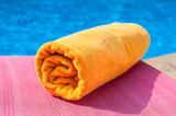 Towel lying on a lounger near the pool