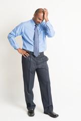 Indian businessman in negative emotion