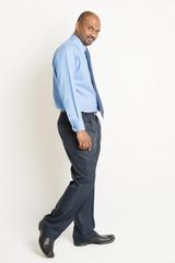 Indian businessman walking
