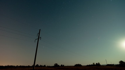 Time lapse of a electricity pylon in front of the milky way