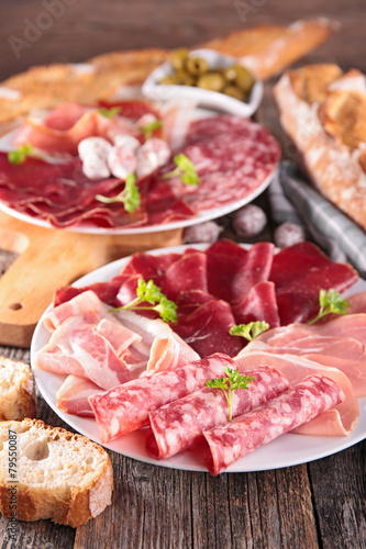 table with meat, bread, olive - 79550087