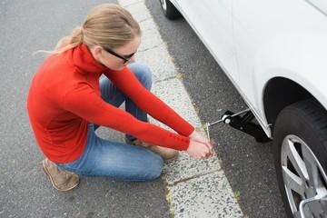 Woman replacing tire