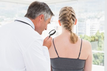 Doctor examining a spot at his patient