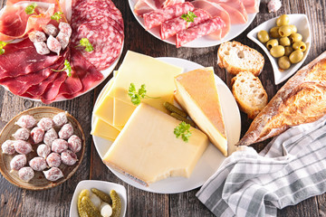 assortment of cheese, meat