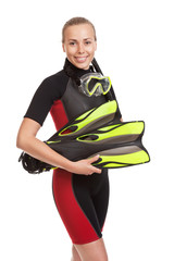 Young smiling blond woman in a wet suit for swimming poses  hold
