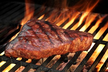 Marinated Beef Steak On The Flaming Hot BBQ Grill.