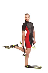 Young smiling blond woman in a wet suit for swimming is in the f