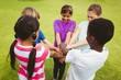 Children holding hands together at park - 79551484
