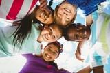 Portrait of happy children forming huddle - Fine Art prints