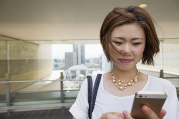 A woman on a walkway in Namba Park office and shopping complex.