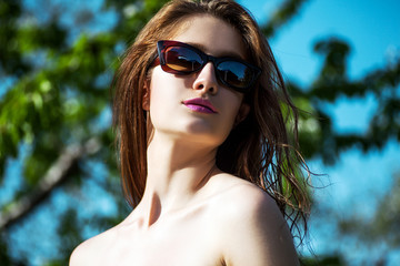 Close-up portrait of beautiful and fashion woman in sunglasses,