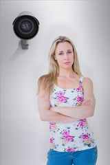 Composite image of pretty blonde unhappy with arms crossed