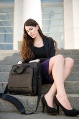 Business woman looking in laptop bag