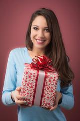 Joyful woman with gift box