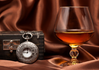 Cognac or brandy and vintage watch on chain