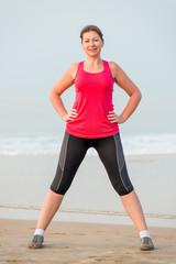 Portrait of the girl in sportswear on the beach
