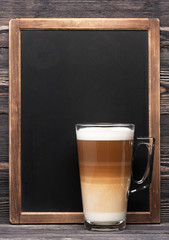 cappuccino or latte and a chalk board with space for text