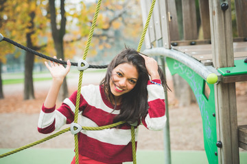 young beautiful indian woman at the park