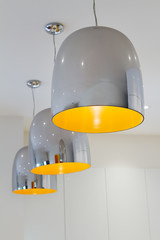 Three chrome and yellow contemporary kitchen pendant lighting