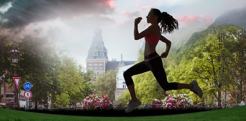 Composite image of full length of healthy woman jogging