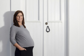 Close up view of a expecting pregnant happy woman