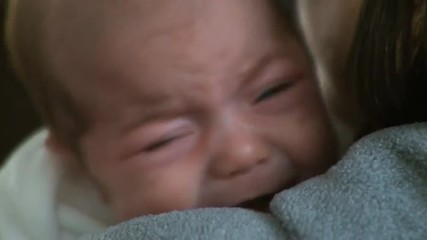 A crying two month old infant.