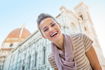 Portrait of happy young woman in front of cattedrale in firenze