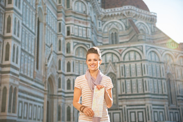 Woman standing with map in front of cattedrale  in florence