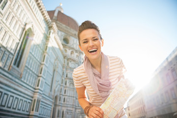 Portrait of woman with map in front of cattedrale  in florence