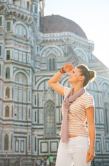Portrait of happy young woman looking into distance  in florence