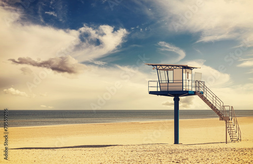 Vintage retro style filtered picture of a lifeguard tower. - 79559286