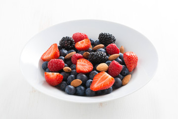 fresh berries and nuts in a plate